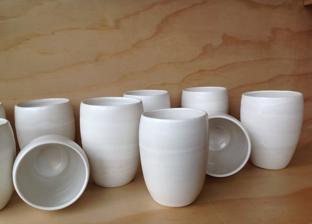 Along with pots, bowls and other vessels Dan has created a specialty line of cups exclusively available at our shop. -
