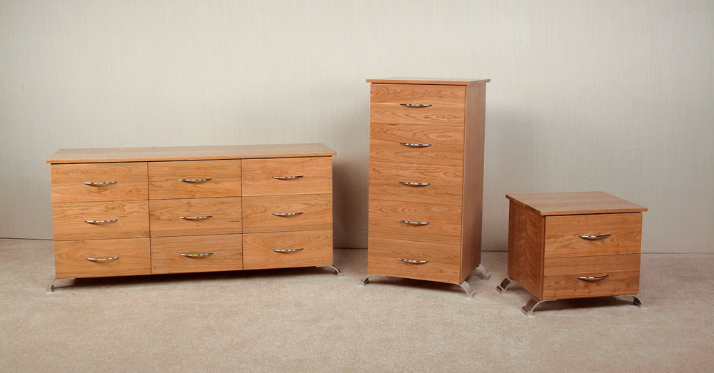 Cherry Bedroom Set: Nine Drawer Dresser. Five Drawer Lingerie Chest. Two Drawer Nightstand.