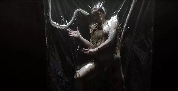 The original incarceration scene (shown in early trailers) dehumanized Polaris even more, which may be the reason it was changed for the premiere.