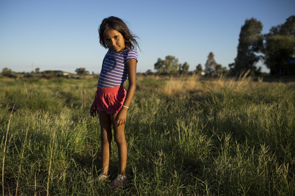 Rhianna Harris, aged 5, in an empty lot near her home in Wilcannia.