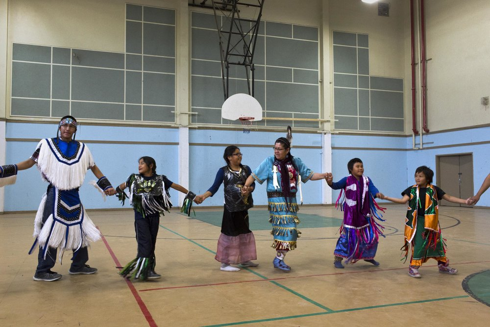 'People of the Parting Rocks' for The Pulitzer Centre on Crisis Reporting .   Pow Wow practice in the Reg Louttit arena in Attawapiskat, Ontario.
