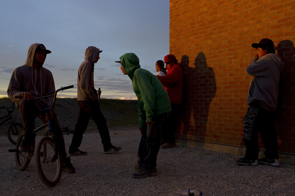 'People of the Parting Rocks' for The Pulitzer Centre on Crisis Reporting . Teens gather at dusk in Attawapiskat, Ontario.