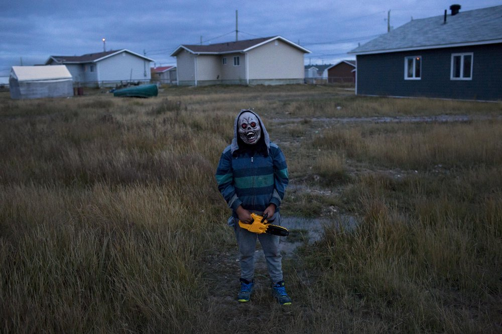 'People of the Parting Rocks' for The Pulitzer Centre on Crisis Reporting . A youth models his Halloween costume in Attawapiskat, Ontario.