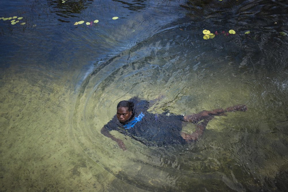 A woman swims in a freshwater spring on Melville Island, Northern Territory.