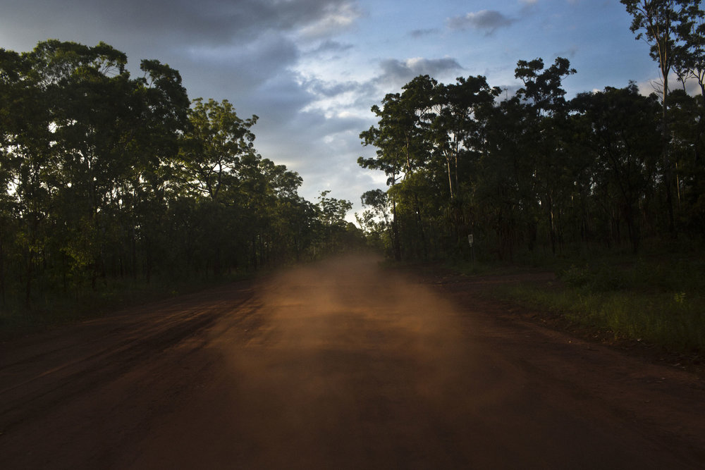 Red dirt rises on a road on Melville Island, Northern Territory.