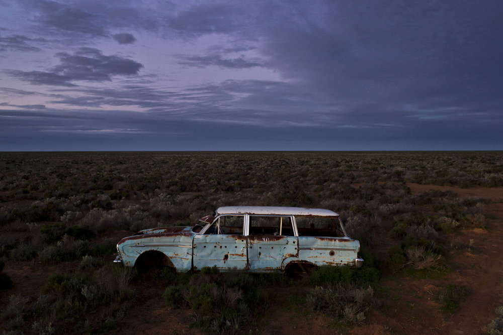 An abandoned car on the old Eyre highway near Yalata, South Australia.