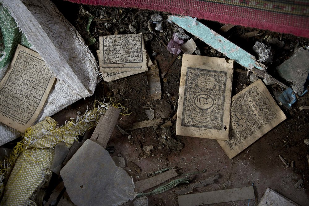 Pages from the holy Koran lay strewn on the ground inside the destroyed Jameo Dansalan mosque in the city of Marawi.