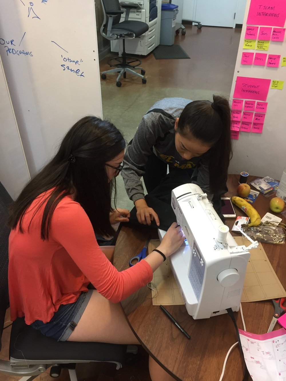 Student using sewing machine