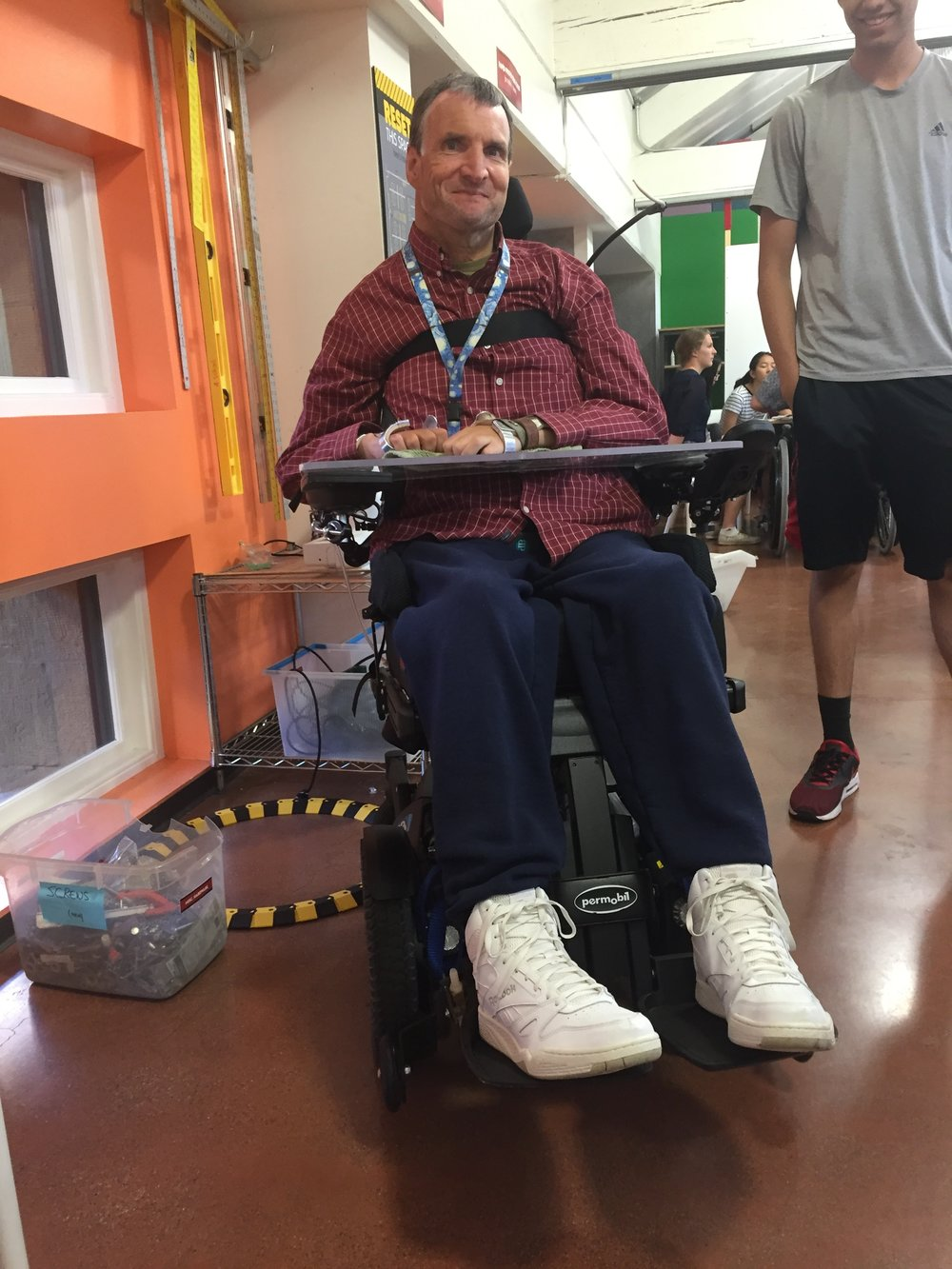 A man in wheelchair smiling