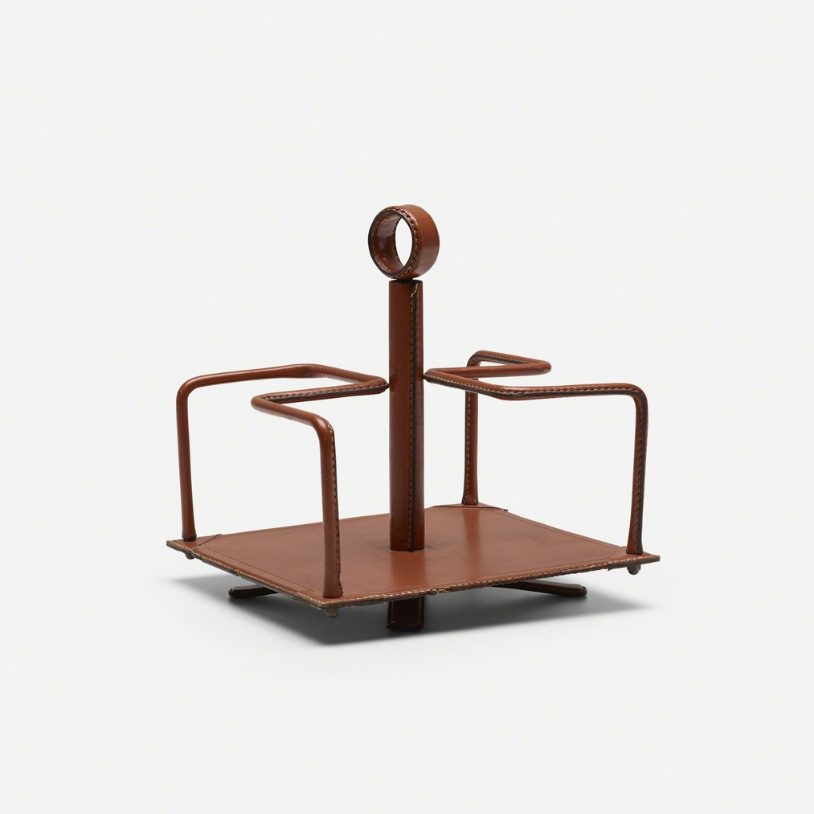 Attributed to Jacques Adnet desk caddy, c. 1950 Saddle-stitched leather over steel, brass