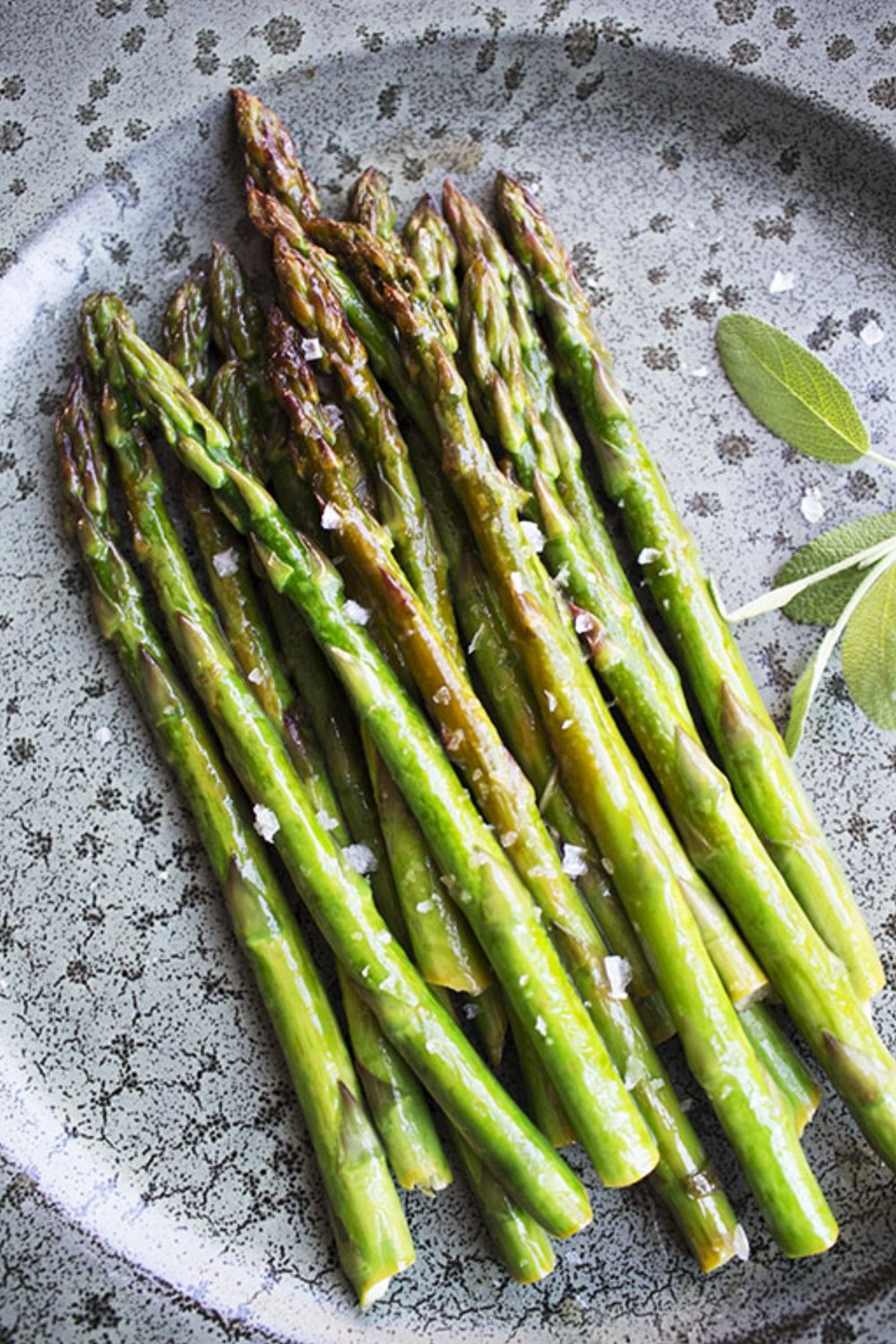 Ingredients:   1 bunch of asparagus  15-20 gr grass fed butter  1 lemon juice  Handful of sage leaves   Pinch of Maldon salt   Method :   1. Put the pan at the stove. Let the butter warm up at the medium heat.  2. Rinse the asparagus and cut the hard lower part.  3.  Add the sage leaves to pan and the juice of half a lemon. Let it caramelise for 1 minute.   4. Place the asparagus to the pan, toss and coat it in the butter-lemon mixture.   5. Let it cook for 5-7 minutes.  6. At the end, add the juce of another half of the lemon, sprinkle with Maldon salt and enjoy!