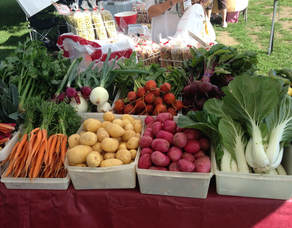 table of vegetables at farmers' market