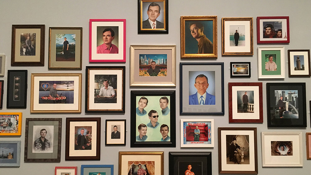 Close up on a group of self portraits by Martin Parr using all sorts of props and photo boots during various trips