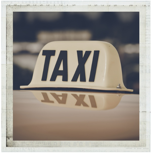 A yellow taxi sign