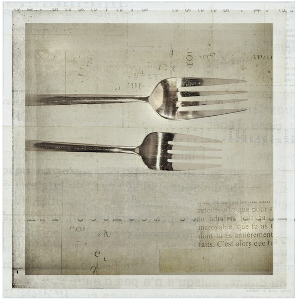 two forks on a table