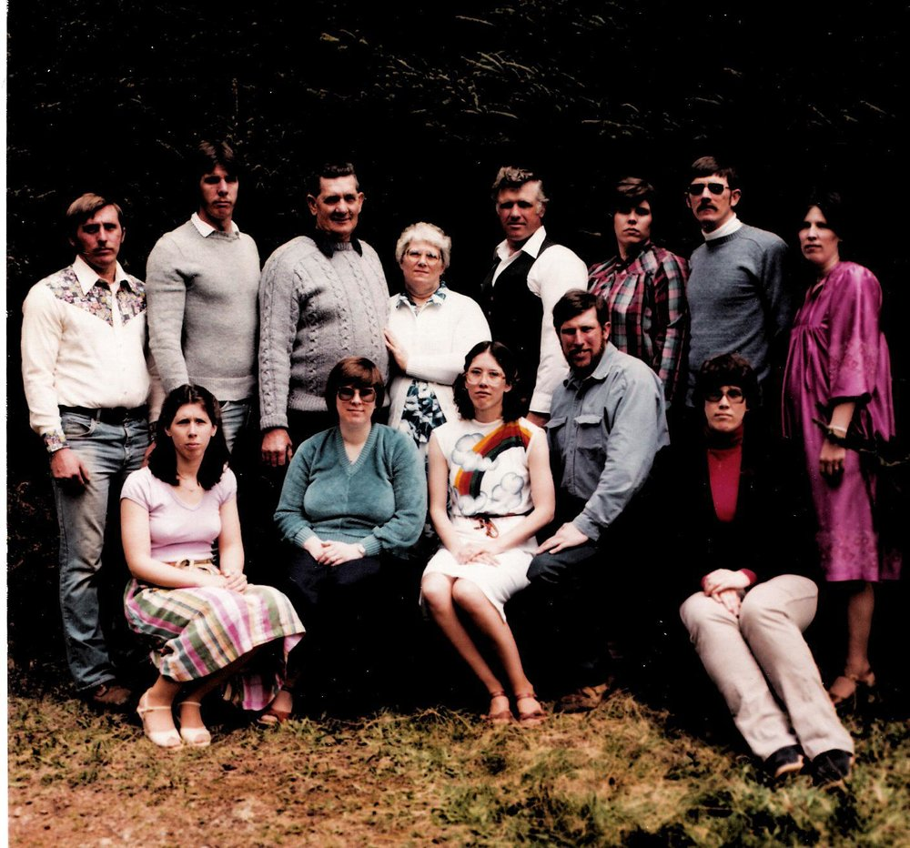 Kate (far right, standing) with her parents and eleven siblings, 1977