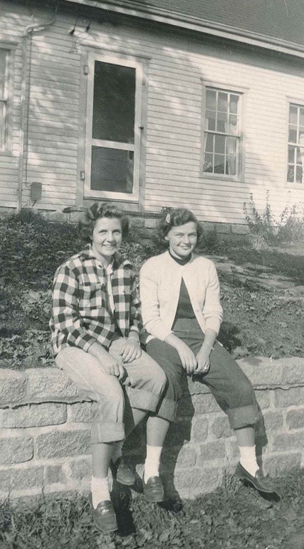 Charlene (left), Doug's wife, with a friend sitting on the wall near the post office