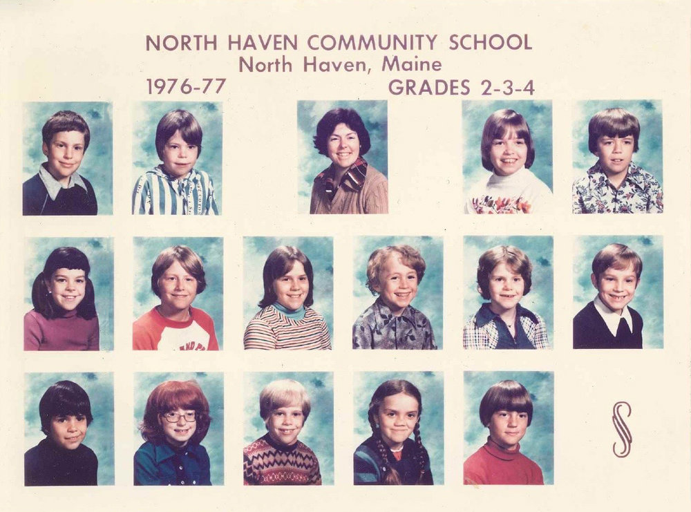 Roman (bottom row, center), along with his friend, Darrin (middle row, right), with the second, third, and fourth grade classes at NHCS