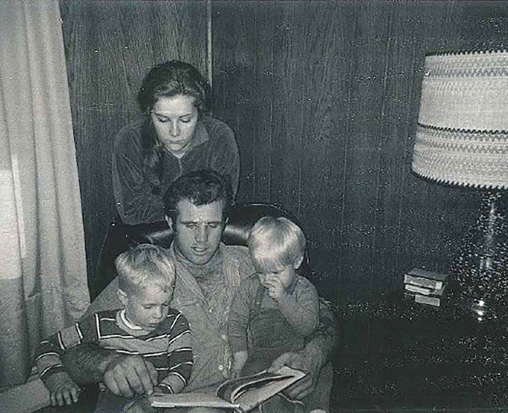Roman (right) with his brother, mother, and father.
