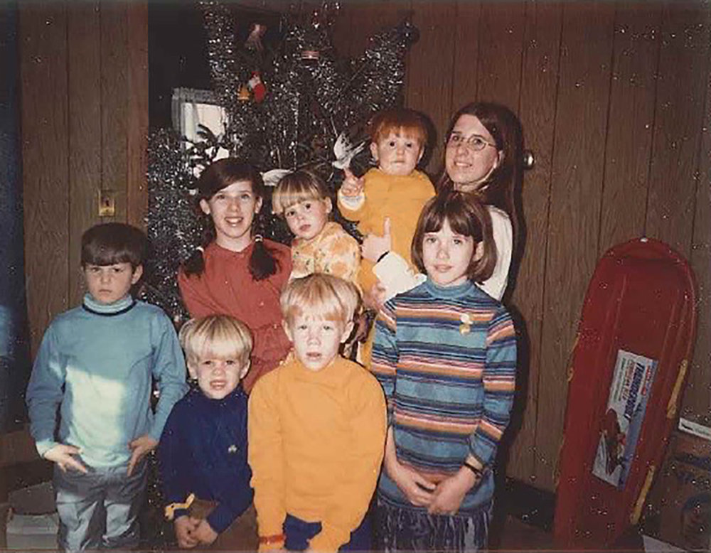 Roman (front row, second from left) with his brother, cousins, and aunts