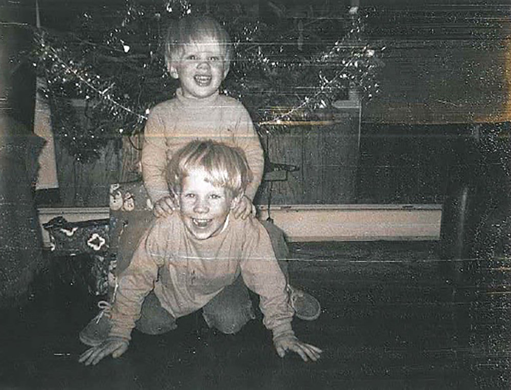 Roman (top) with his older brother, Shawn.