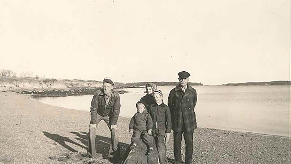 Betty and her family at the beach. – (From left to right)Brother Hugh,Sister Thelma, Grandfather William Dole, Brother Victor, Betty (on rock, at about age 5)