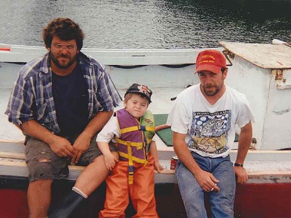 Zeb (center) on his father's boat with his uncle (left) and his father (right)