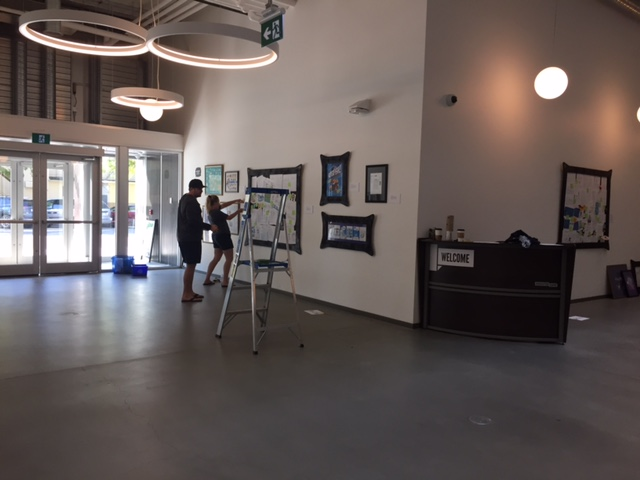 Inside the okanagan innovation centre on doyle ave. in Kelowna, with the help of one of an art gallery professional, we put up the process display.