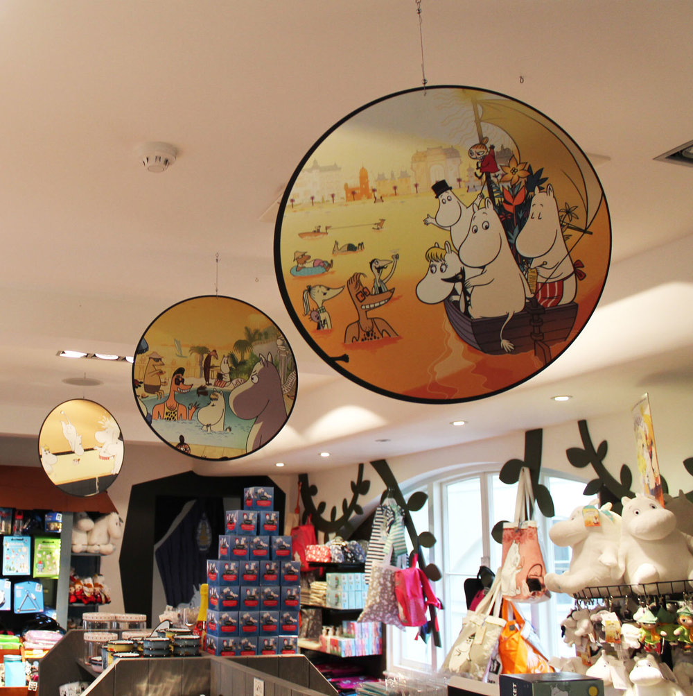 Hanging cartoon disc in gift shop