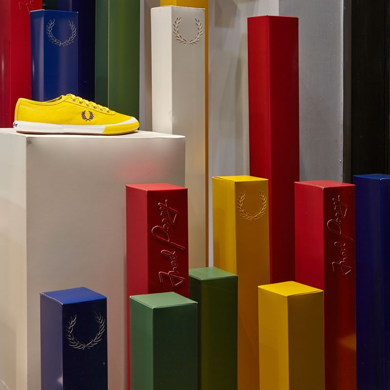 Coloured long blocks displaying shoes