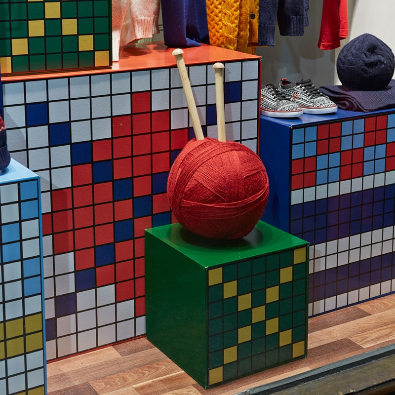 Mosaic plinths displaying large wool ball window display
