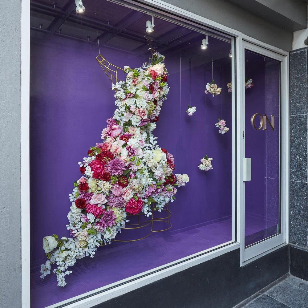 Hanging wire dress structure with flowers attached