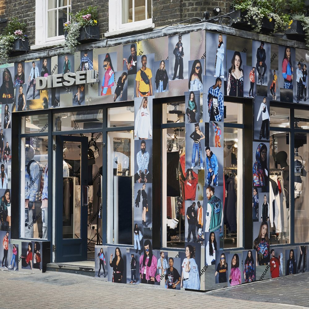 Exterior of Diesel building clad in mirror and London Fashion Week photography