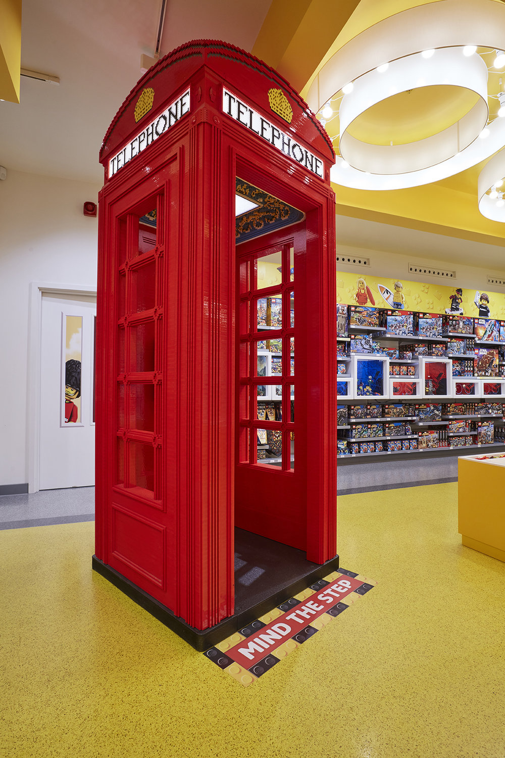 LEGO telephone box with vinyl on the floor