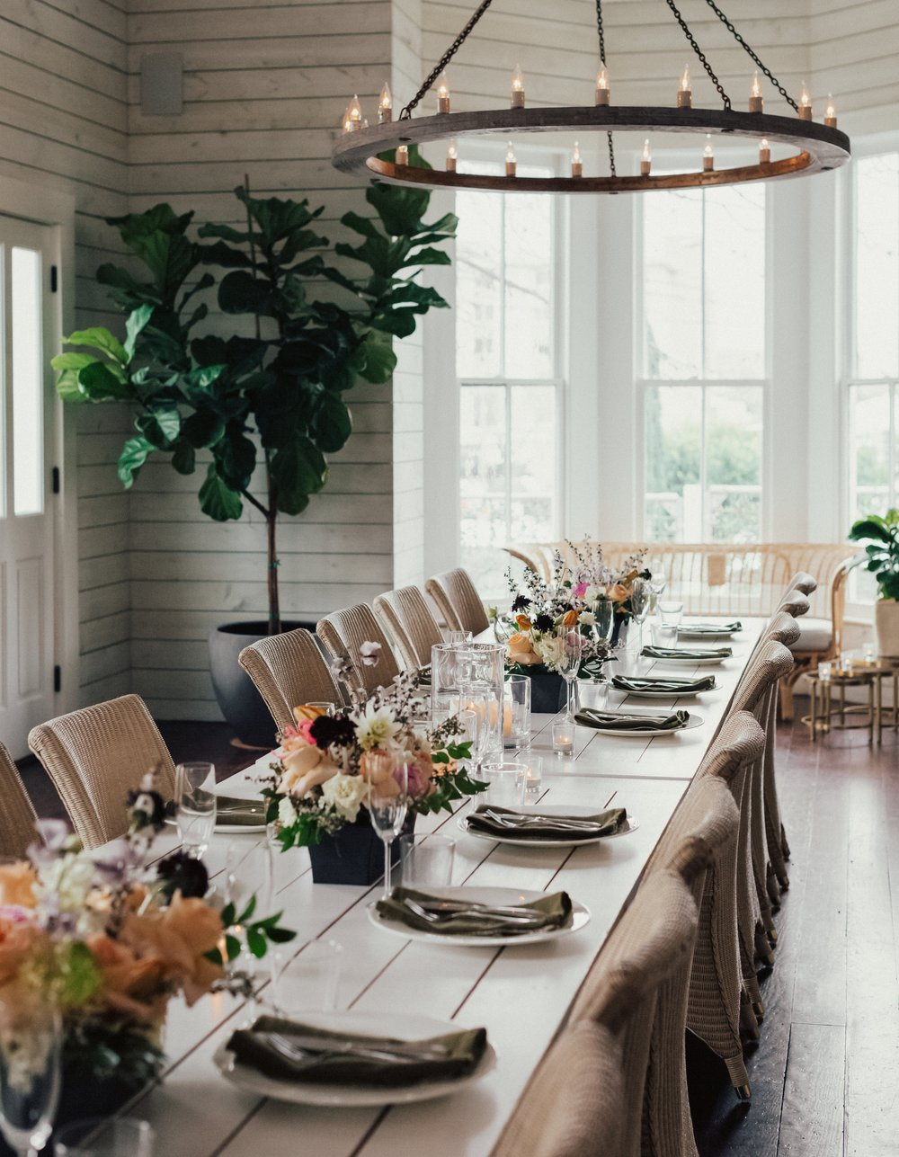 Event Centerpieces - All-sided urn or vessel arrangements, in Earl Grey's lush style, and designed to your color palette. Starting at $70.00. Photo: Leeann Funk Photography.Venue pictured: Thompson + Hanson Garden House