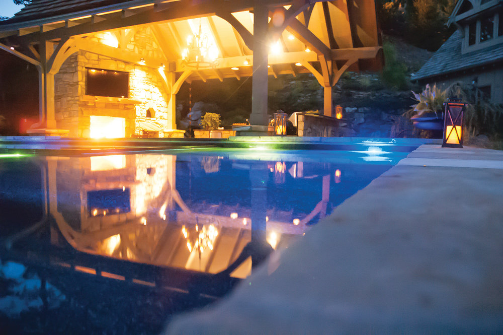 While you're enjoying the pool or spa, the ambiance of the fireplace, swim-up bar and flat panel TV allow you to relax and enjoy the setting even after sunset.