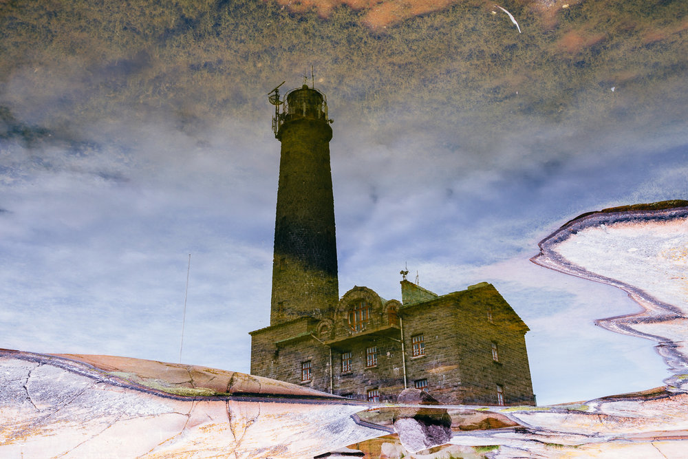 Bengtskaer Light House (reflection from the puddle)