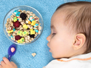will feeding my baby solid foods make them sleep through the night?