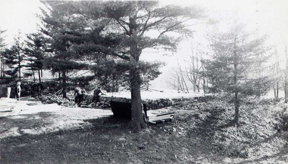 Building the fourth cottage, foundations, about 1950.