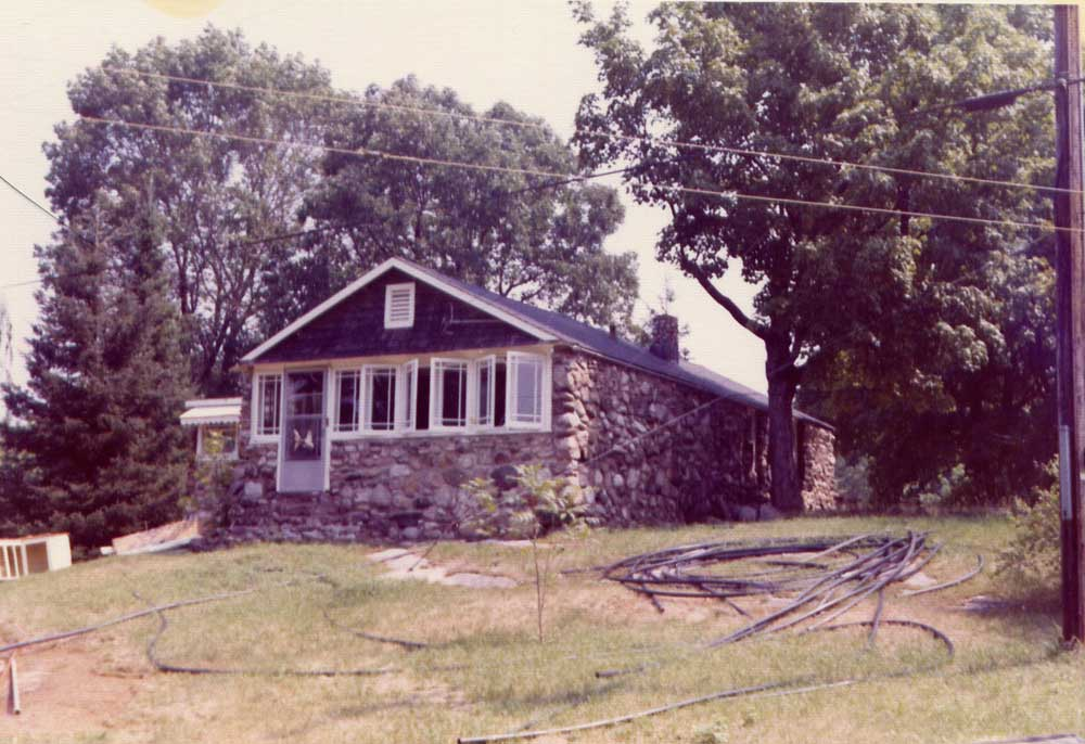 A maturing property by about 1975. Trees have grown up and improvements are made to water supply and discharge.