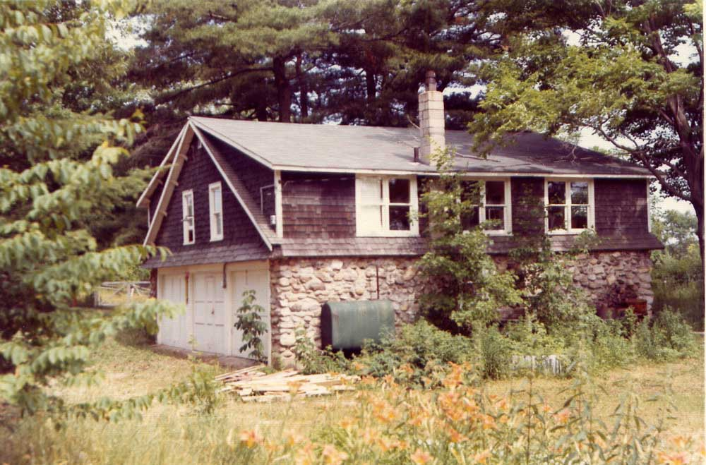 The main house with three bay garage, falling into disrepair about 1975.