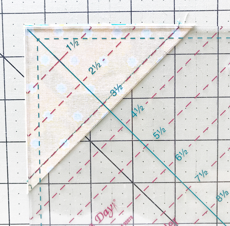 Quilt in a Day Ruler trimming HST.jpeg