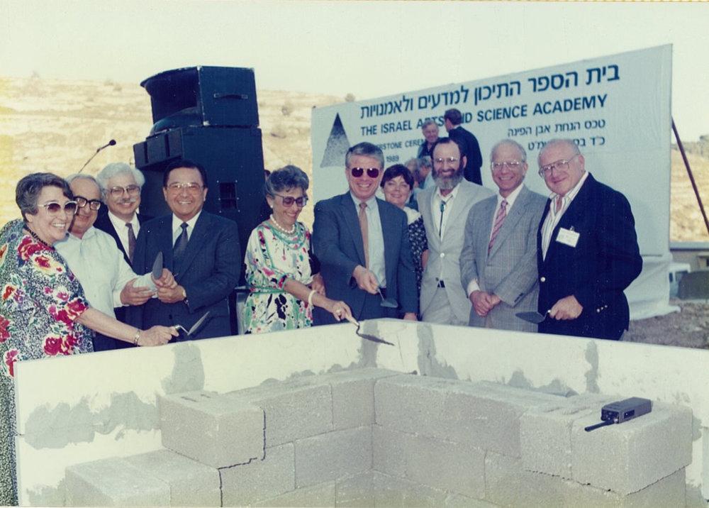 From left: Mary Jane Asher, Minister of Education Yitzhak Navon, Daniel Lowe, Senator Daniel Inouye, Lynn Schusterman, Bob Asher, Judith and Gil Asher, Charles Schusterman, Irwin Hochberg.