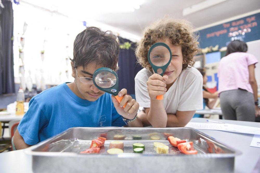 boys with magnifier-benny doutsh.jpg