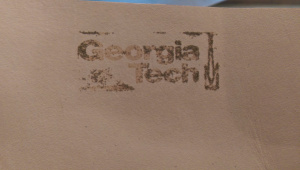 Despite a solid ink print, very little of the embossing powder stuck to the leather.
