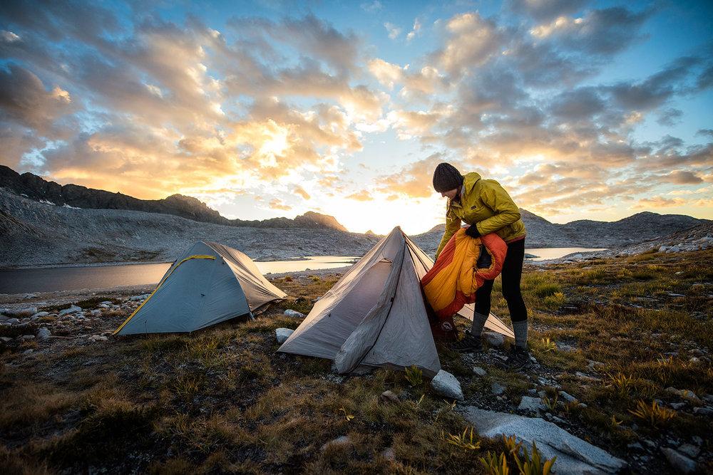 austin-trigg-big-agnes-tent-john-muir-trail-camping-Kerry-pulls-sleeping-bag-Lake-Wanda-Sunset.jpg