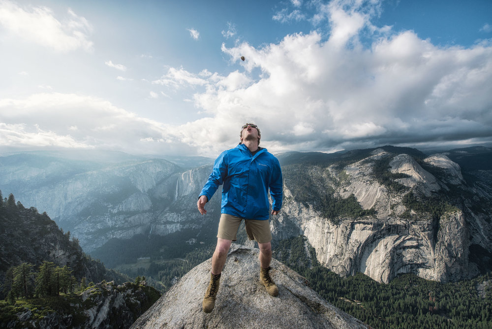 austin-trigg-yosemite-national-park-playing-food-catch-mouth-glacier-point-waterfall-clouds-california-adventure.jpg