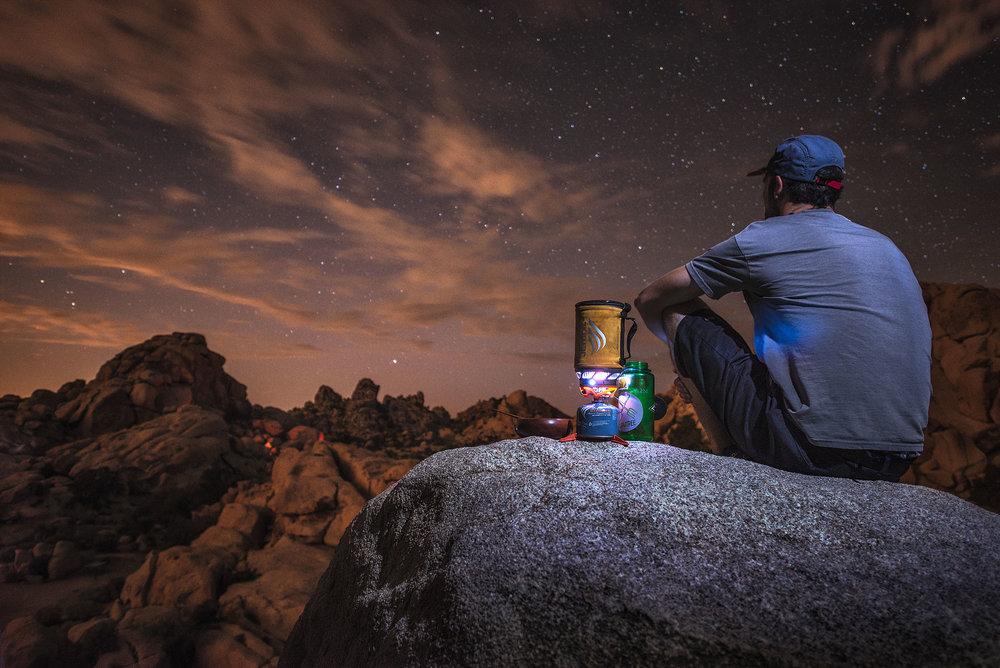 austin-trigg-joshua-tree-national-park-camping-stove-night-sky-cook-dinner-rock.jpg