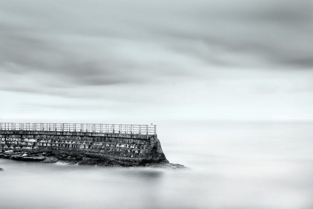 austin-trigg-southern-california-Childrens-pool-la-jolla-black-white-long-exposure-daytime-ocean-san-diego-california.jpg