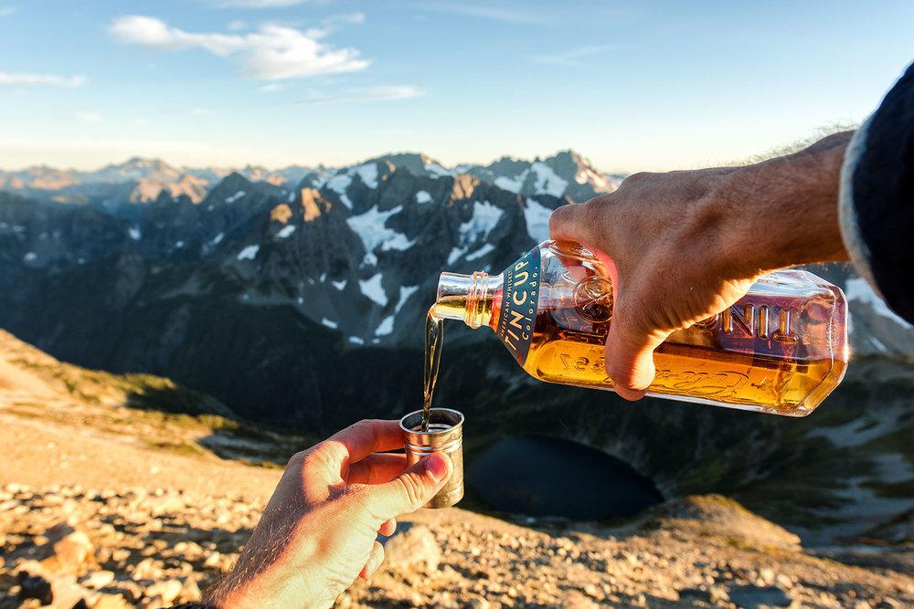 austin-trigg-whiskey-lifestyle-washington-north-cascades-mountains-bottle-pour.jpg